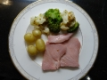 Gammon cooked in Ginger Ale seved with new pots & Broccoli and Cauliflower herb topping